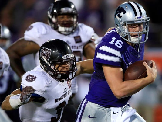 Kansas State quarterback Jesse Ertz (16) gets tackled by Missouri State linebacker Dylan Cole (31) after a 35-yard run during the first half of an NCAA college football game in Manhattan, Kan., Saturday, Sept. 24, 2016. (AP Photo/Orlin Wagner)