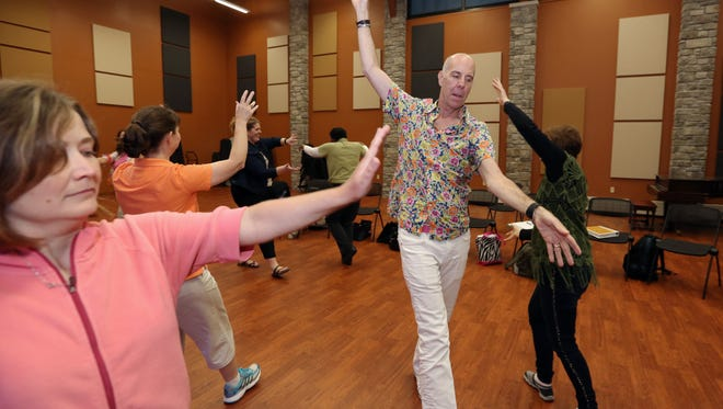 Dr. John Feierabend, center, leads the awareness of flow exercise of the Kodály Methods, originated from Hungary, to eight workshop music educators at Silver Lake College Franciscan Center for Music Education and Performance on Thursday, July 7. The Kodály Methods, developed by Hungarian Zoltán Kodály during the mid-20th century, is an experience-based approach combining classic and folk music. Thirty music educators participated in the Kodály Summer Music Program June 27-July 8.