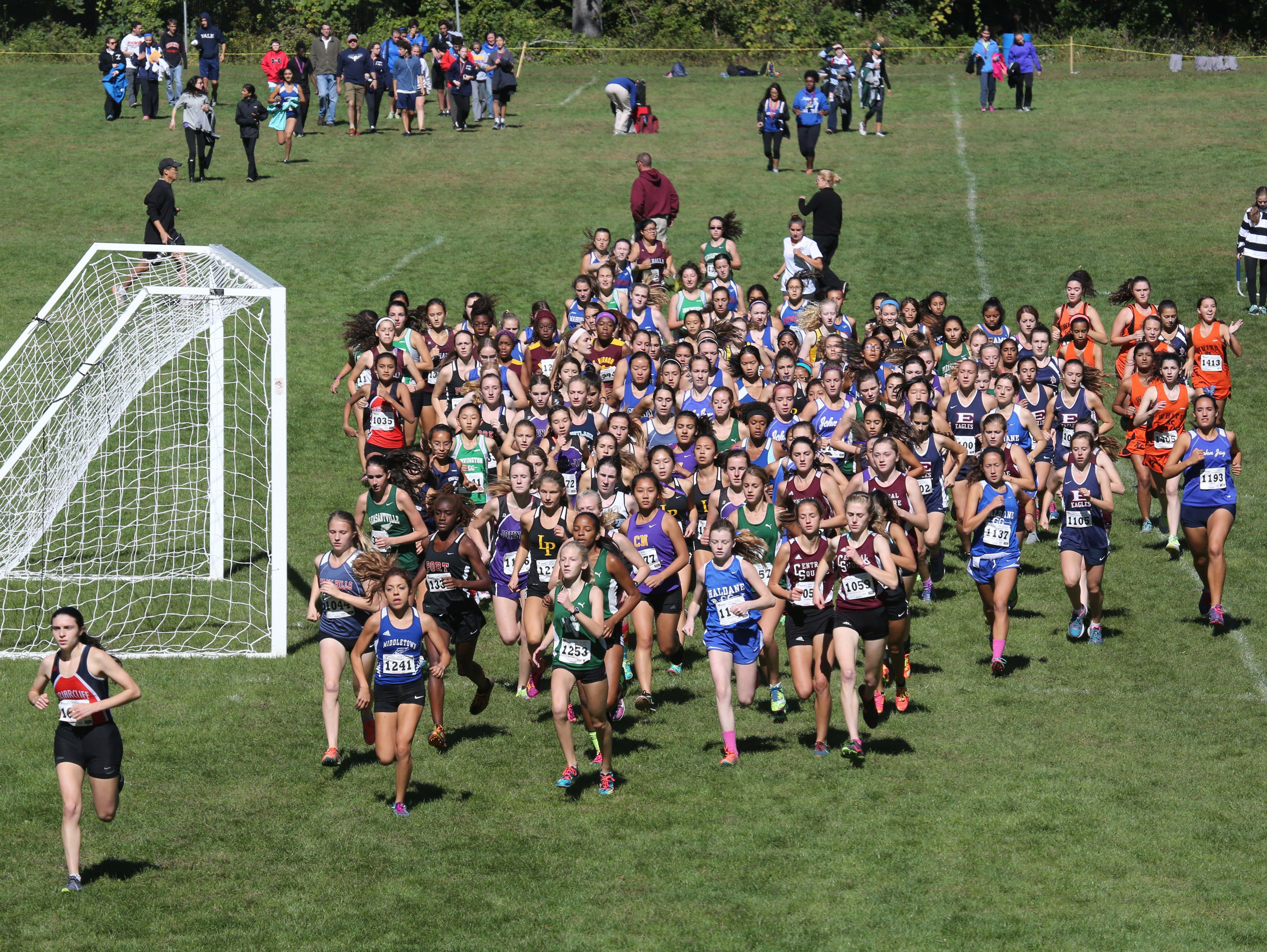 The start of the girls varsity race during the Bobcat Run cross country meet at Byram Hills High School in Armonk, Oct. 10, 2015.