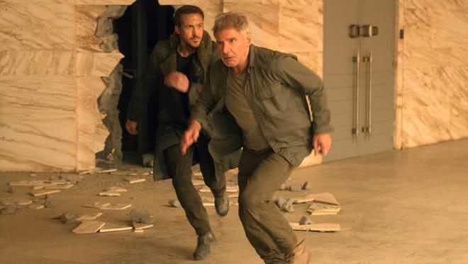 "Ryan Gosling (left) and Harrison Ford run for cover in ""Blade Runner 2049."""
