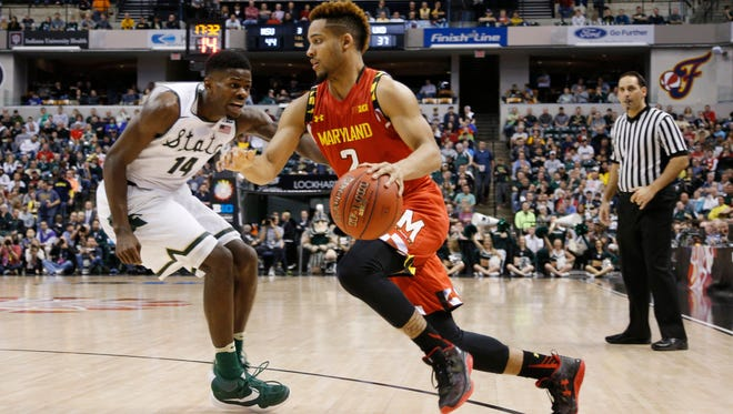 MSU's Eron Harris (14) guards Maryland's Melo Trimble during Saturday's Big Ten Tournament semifinal at Bankers Life Fieldhouse in Indianapolis. Harris and the Spartans held Trimble to just 11 points on 2 of 15 shooting.