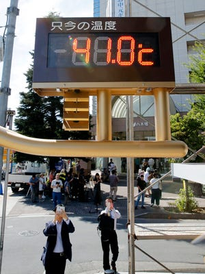 The thermometer reads 105.8 degrees Fahrenheit in Kumagaya, north of Tokyo. Searing-hot temperatures are forecast for wide swaths of Japan and South Korea in a long-running heat wave.