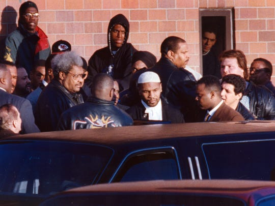Mike Tyson is released from the Indiana Youth Center near Plainfield, Indiana in March 25, 1995. With him is boxing promoter Don King.