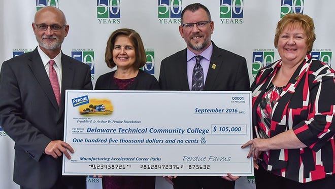 Delaware Technical Community College accepted a three-year grant from the Franklin P. and Arthur W. Perdue Foundation for the Advanced Manufacturing Pathways Program in Kent and Sussex counties. From left, Chief Operating Officer of Perdue Farms Randy Day, Vice President and Owens Campus Director Dr. Ileana Smith, Assistant Vice President for Workforce Development and Community Education Paul Morris, and Vice President and Terry Campus Director Dr. June Turansky.