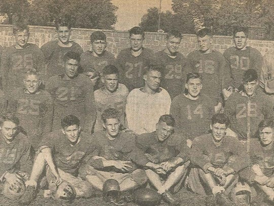 Dan Coborn is No. 14 on the Sauk Rapids High School football squad for 1945. Shown left to right are: (front row) Jim Opatz, Dick Olson, John Kinney, Ken Walters, Al Repulski, Ralph Gorecki, Ed Repulski, and Rick Agather; (second row) assistant manager Vic Burski, Dennis Patton, Gene Bolinski, Don Wichman, Otto Wichman, Al Sumbs, Dan Coborn, Lester Fischer, and Delroy Repulski; (third row) manager Lloyd Koprek, Ken Maurer, Bill Soder, Dan Gorecki, Tony Tarnowski, Marv Blaske, Clarence Tadych, Bob Skinner, Roy Hahn, and coach Beno Mileti.