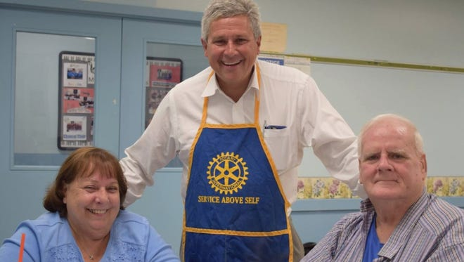 Rotarians Jodi DiPane-Saleem (left) and state Sen. Kip Bateman (center) with Thomas O'Leary at a Branchburg Rotary cooking event for SHIP.