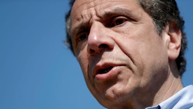 New York Gov. Andrew Cuomo speaks while atop a small boat about the recent news of  state Attorney General Eric Schneiderman, Tuesday, May 8, 2018, in Tarrytown, N.Y. Cuomo, who was on the boat during a media tour to showcase the dismantling of the old Tappan Zee bridge and the talk about the new Mario Cuomo Bridge, commented on Schneiderman's resignation just hours after accounts of abuse by four women. (AP Photo/Julio Cortez)
