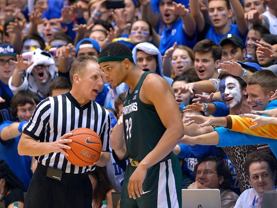 Cameron Crazies taunt Miles Bridges, as he talks with