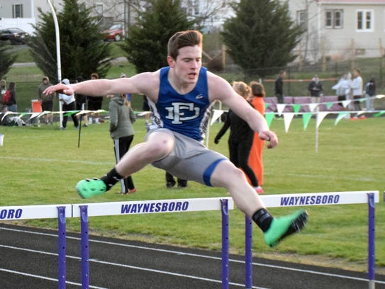 Fort Defiance's Matt Wonderly clears the next to the