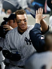 Aaron Judge is congratulated by teammates after hitting a solo home run in the third inning against the Blue Jays on Tuesday night at Yankee Stadium.
