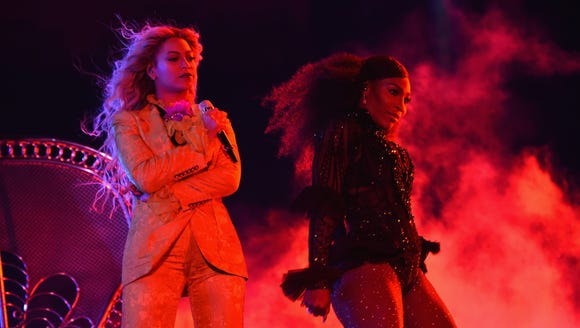 Beyonce and Serena Williams perform on stage during