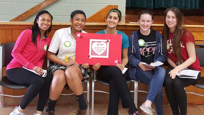 Students at Our Lady of Mercy Academy are ready to donate blood during the school's first blood drive.