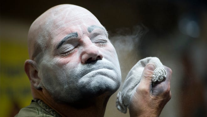 """Brian """"Ranger Joe"""" Bullock, the Hadi Shrine Funsters' newest member, applies powder to set his """"Hobo"""" style of clown makeup at the Funster barn in Evansville, Ind., on Monday, Nov. 13, 2017. Bullock was taught to apply his own makeup for the first time that evening."""