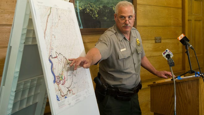 Steve Kloster, chief ranger at the Great Smoky Mountains National Park, shows a map outlining their search routes for Austin Bohanan.