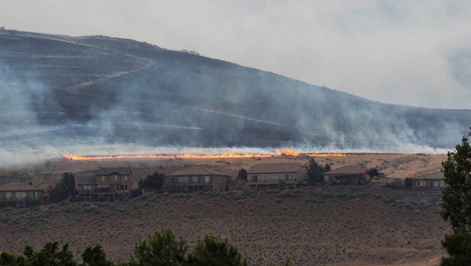 The brushfire burning in Sparks is shown on Sunday afternoon.