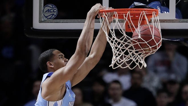 North Carolina forward Garrison Brooks dunks against Duke during the second half of an NCAA college basketball game in the Atlantic Coast Conference men's tournament semifinals Friday, March 9, 2018, in New York. North Carolina won 74-69. (AP Photo/Julie Jacobson)
