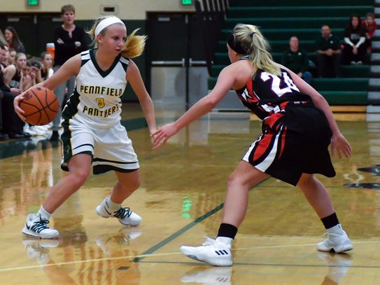 Pennfield's Naomi Davis (3) works to get past Marshall