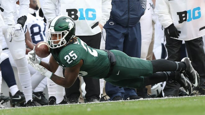 Michigan State's Darrell Stewart dives for a pass during first quarter action against Penn State  Saturday, November 4, 2017 at Spartan Stadium in East Lansing.