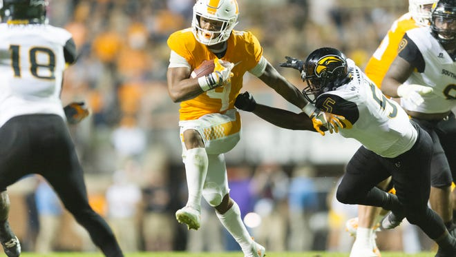 Tennessee running back John Kelly (4) runs the ball during an game between Tennessee and Southern Miss at Neyland Stadium in Knoxville, Tennessee, on Saturday, Nov. 4, 2017.