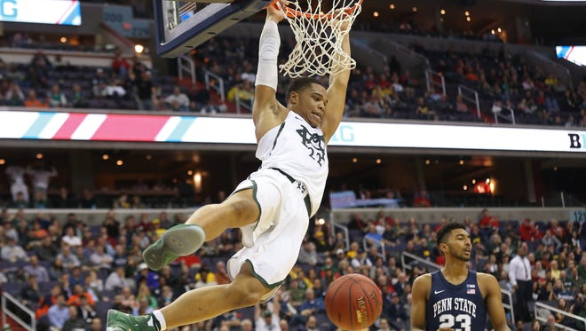 Mar 9, 2017; Washington, DC, USA; Michigan State Spartans guard Miles Bridges (22) dunks the ball as Penn State Nittany Lions guard Josh Reaves (23) looks on in the first half during the Big Ten Conference Tournament at Verizon Center. Mandatory Credit: Geoff Burke-USA TODAY Sports