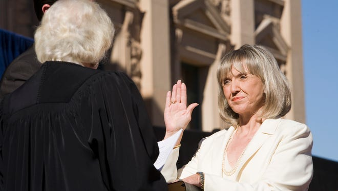 Secretary of State Jan Brewer takes the oath of office from retired U.S. Supreme Court Justice Sandra Day O'Connor at the Arizona Capitol on Jan. 4, 2006.