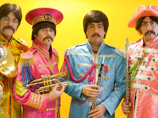 Nate Bott, left, Axel Clarke, Chris Paul Overall and Jesse Wilder of the Beatles tribute act Abbey Road don Sgt. Pepper outfits.