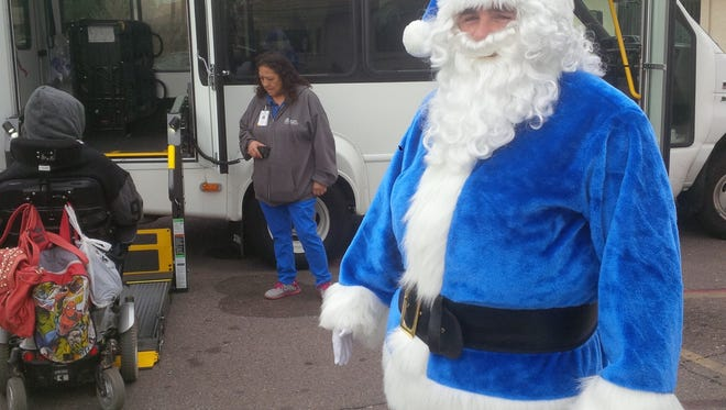 A member of the Phoenix Police Department poses as Santa.
