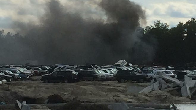 A fire rages at Cosmo's Recycling on Double Trouble Road in Berkeley.