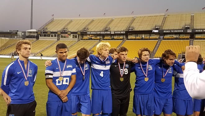 The Summit Country Day boys' soccer team celebrates its state title.