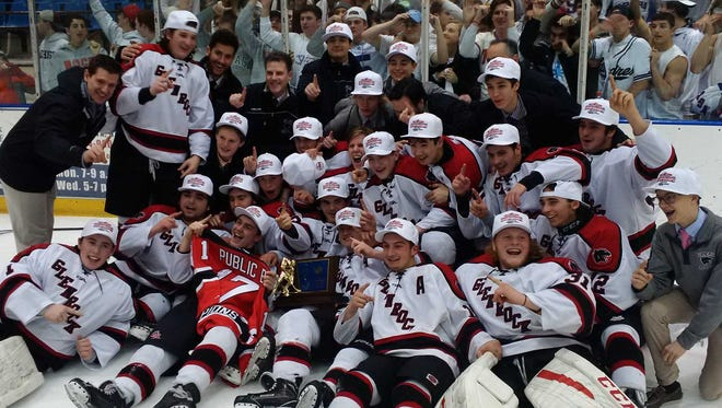 Glen Rock celebrates with fans after capturing its first-ever Public B state hockey championship at Mennen Arena on March 6, 2017.