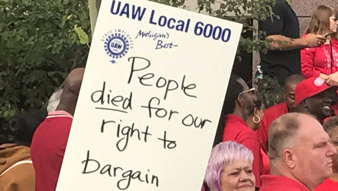 State employees and union members protest outside the Michigan Civil Service Commission meeting in downtown Lansing on Sept. 20, 2017.