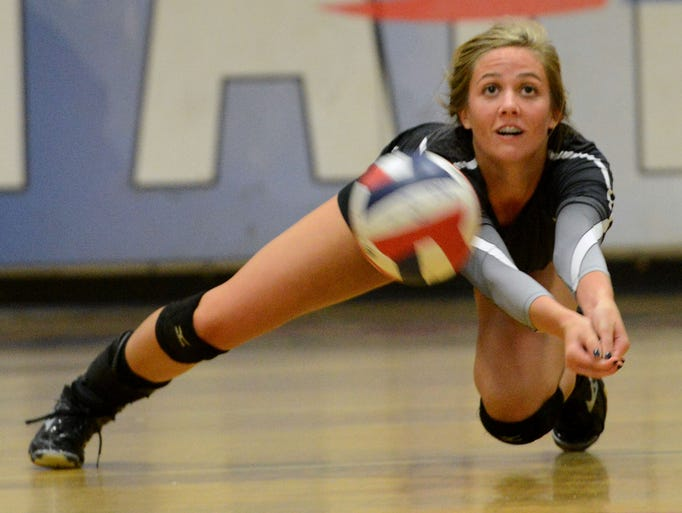 Catholic High School's Olivia Williams dives to receive a serve from Pace High on Monday during a season opener in Pace.