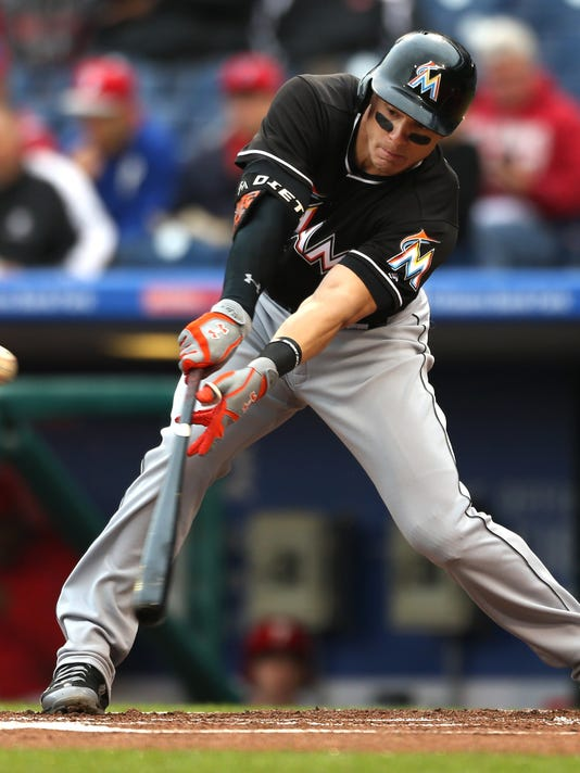 Miami Marlins' Derek Dietrich hits a single on a pitch by Philadelphia Phillies starting pitcher Vince Velasquez in the first inning of a baseball game, Tuesday, May 17, 2016, in Philadelphia. (AP Photo/Laurence Kesterson)