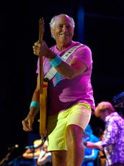 Jimmy Buffett and the Coral Reefer Band are seen in a 2015 performance at the Wharf Amphitheater in Orange Beach, Ala. Buffett and co. will return to the venue May 31.