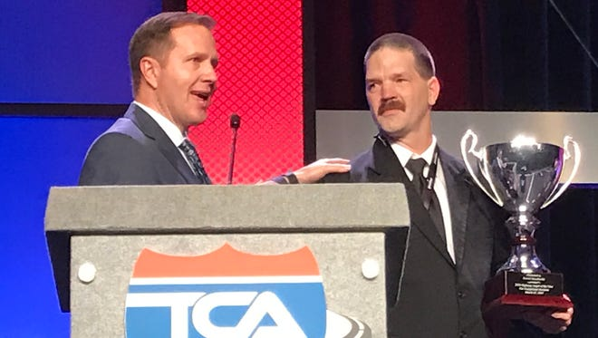 Daniel Sieczkarski, right, of Rochester, receives the Highway Angel of the Year award from the Truckload Carriers Association.