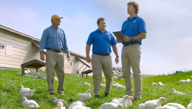 Chris Perdue, center, and Ryan Perdue, part of the fourth generation of Perdues working in the family business, join their father, chairman and advertising spokesman Jim Perdue in one of two new commercials promoting Oerdue Harvestland organic chicken.