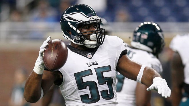 Philadelphia Eagles linebacker Brandon Graham tosses a football before a game against the Detroit Lions on Nov. 26, 2015, in Detroit.