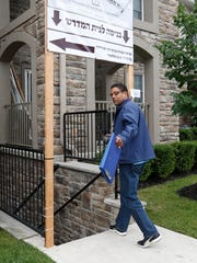 Spring Valley Building Inspector Walter Booker tries to gain entry to the Parkview Condominiums in this file photo..