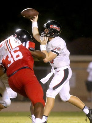 Maryville's quarterback Braden Carnes (16) passes the ball as Oakland's Aaron Moore (36) moves in for a tackle during the game, on Friday, Aug. 25, 2017, at Oakland.