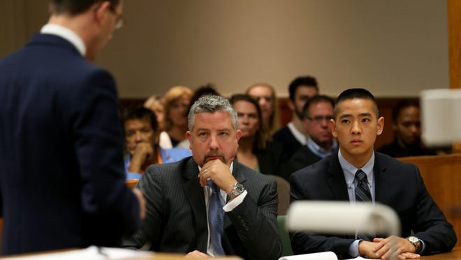 Charles Tan and his attorney James Nobles listen to co-council Brian DeCarolis make his opening remarks in his murder case.