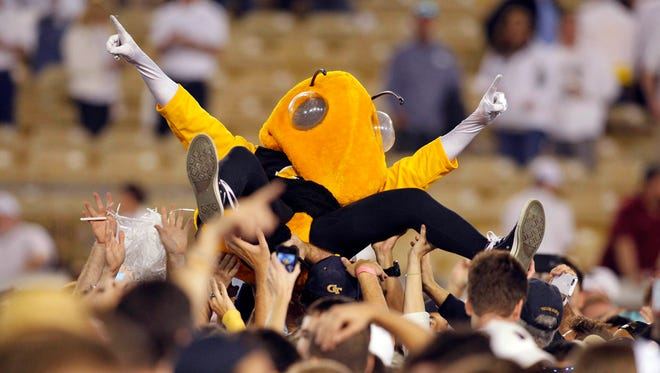 Georgia Tech Yellow Jackets mascot Buzz is carried by fans after a game against the Florida State Seminoles at Bobby Dodd Stadium. Georgia Tech defeated Florida State 22-16.