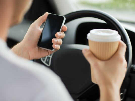 close up of man using phone while driving the car