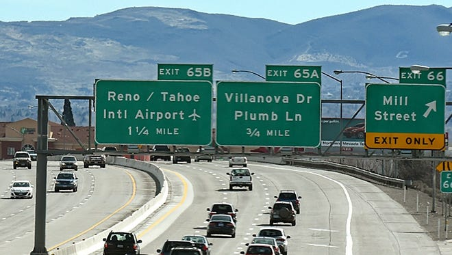 Traffic movies along the I-395 next to the Mill Street exit in Reno.