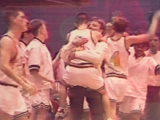 Joe McGuinness, pictured hugging Pat Buckley, who is