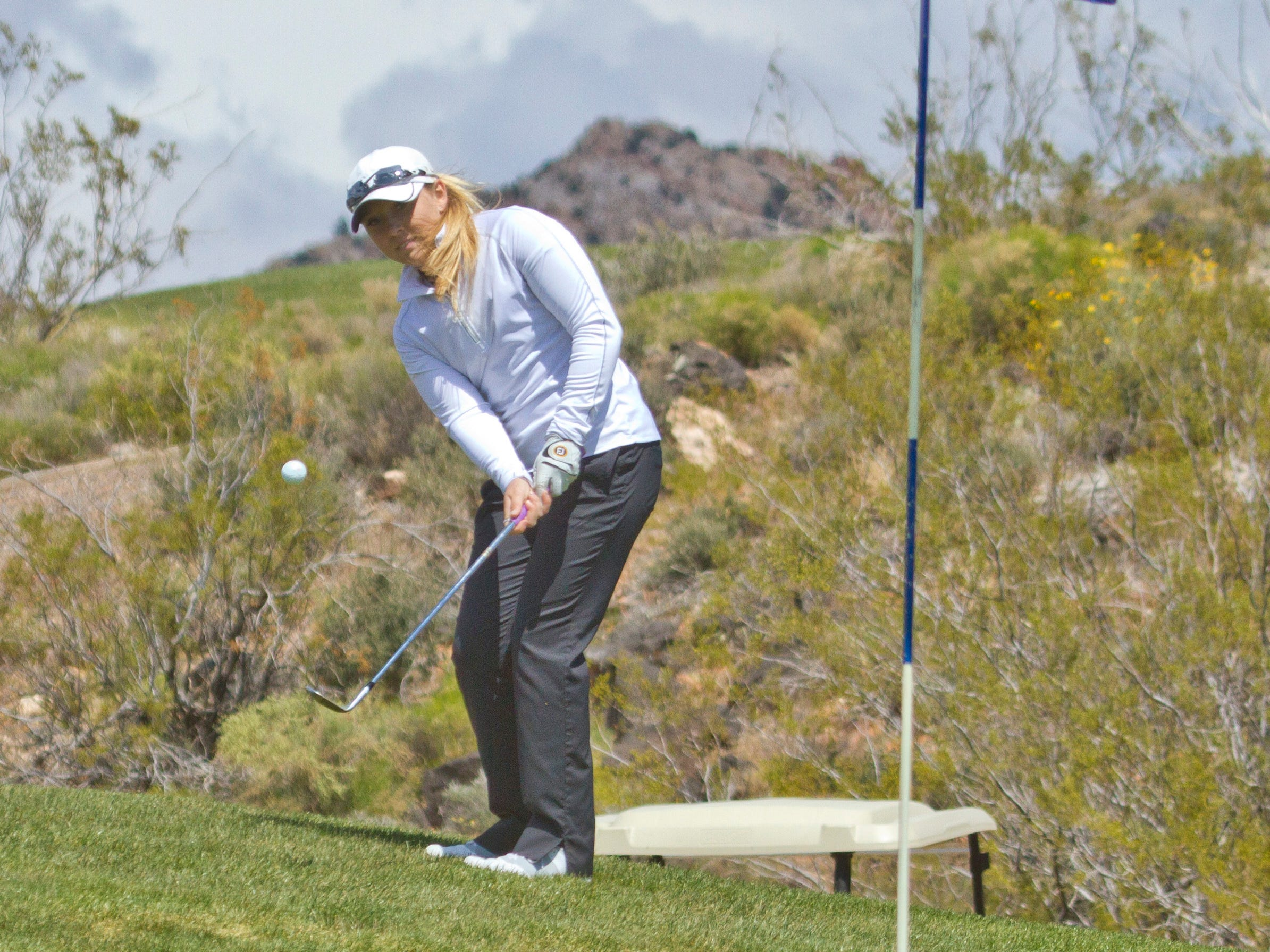 Pine View golfer Taylor Bandley ships on the green at Sky Mountain Thursday, April 16, 2015.