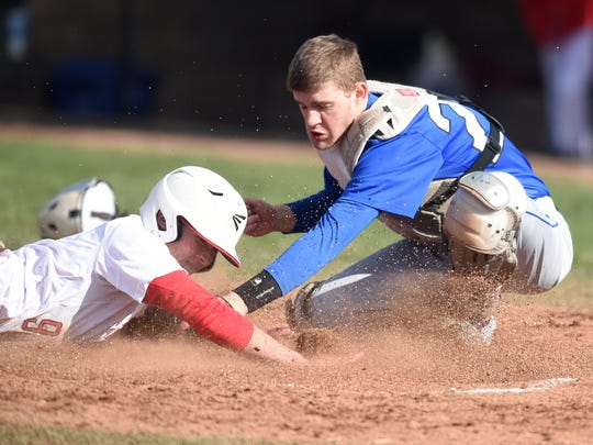 Centerville's Bennett Walther tags out Seton's Vincent Falcone at the plate Saturday, April 1, 2017 during a baseball game on John Cate Field at McBride Stadium in Richmond.
