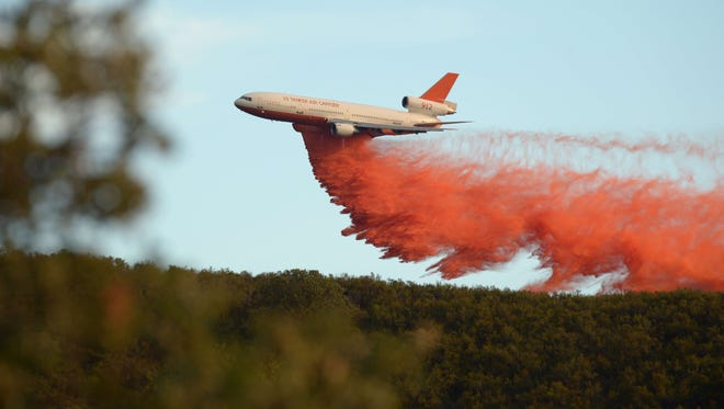 An air tanker drops fire retardant along a ridge to help contain the Rocky fire near Clearlake, California on August 2, 2015. 73