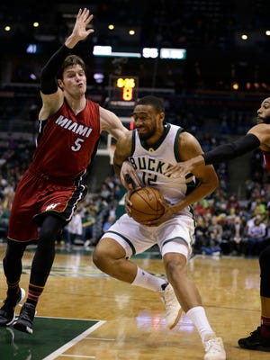 The Milwaukee Bucks' Jabari Parker grimaces as he drives against the Miami Heat's Luke Babbitt during the second half Feb. 8 in Milwaukee.