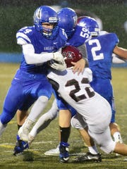 Lakeland ball carrier Dylan Kutzleb (left) is tackled