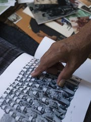 Joe Sorrelman looks at a photo of his Marine Corps 2nd Infantry Training Regiment, from 1966.